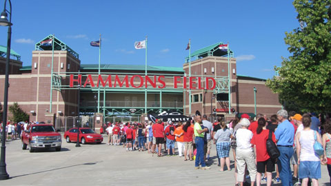 "Fans line up in front of Hammons field to show support for the ""Baby Birds."""